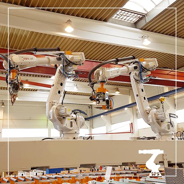 zwei roboter verpacken vollautomatisch Aluminiumprofile